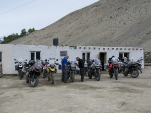 Motorcycles parked outside Home-Stay in Tajikistan