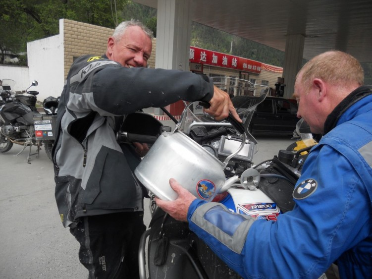 Filling our bikes with kettles of fuel