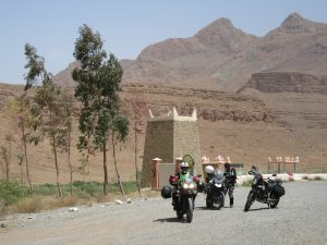 Three motorcyclists take a scenic rest break in Morocco